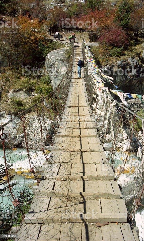 Suspension bridge in the Himalayas royalty-free stock photo
