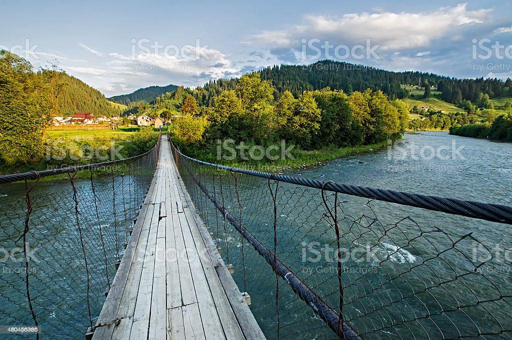 Suspension bridge over the river stock photo