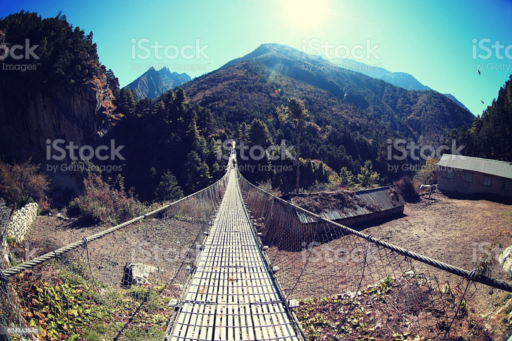 suspension bridge over the river stock photo