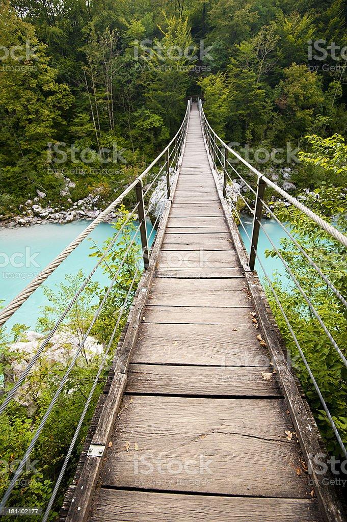 Suspension bridge over the Soca river stock photo