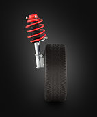 suspension of the car with wheel solated on black background