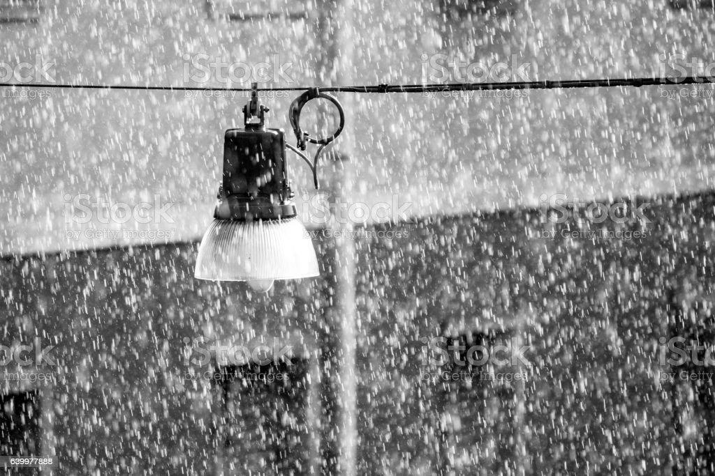 Suspension street lamp in the rain stock photo