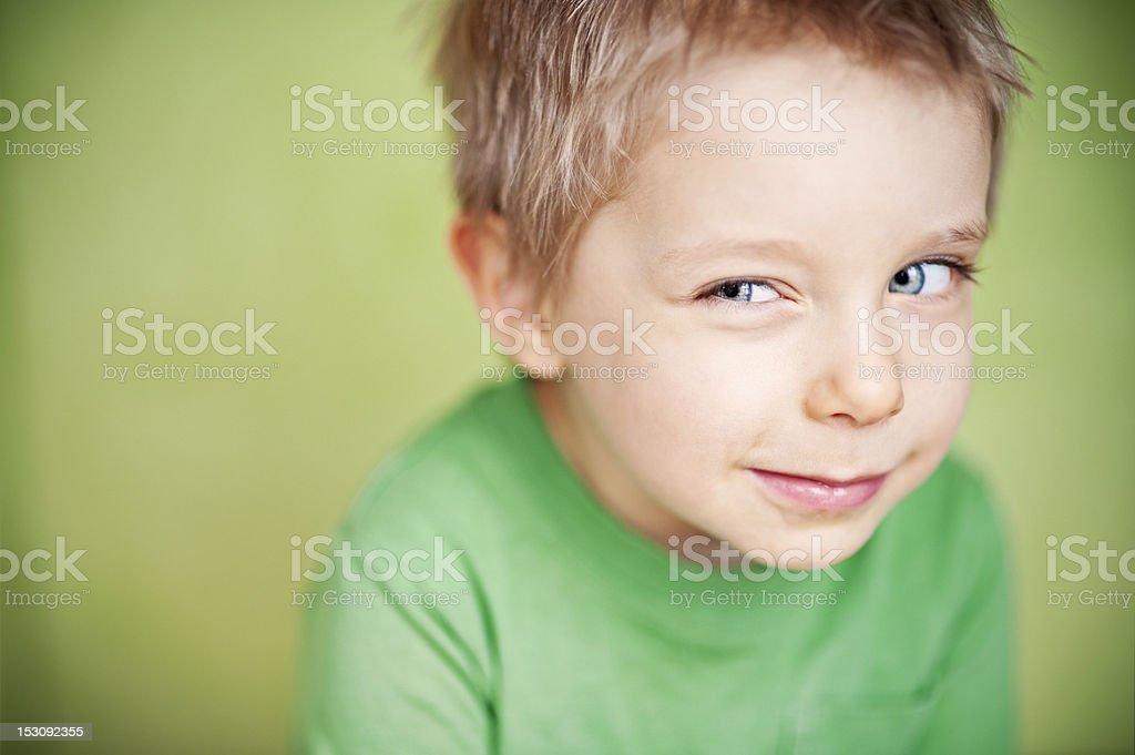 Suspicious funny green boy royalty-free stock photo