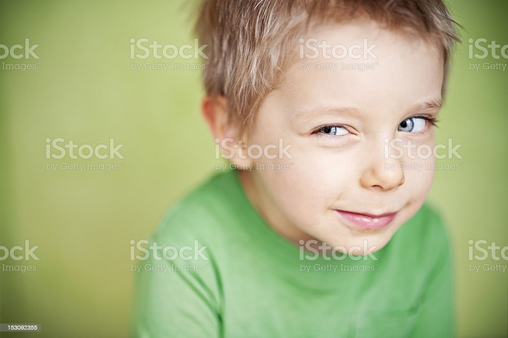 Suspicious funny green boy stock photo