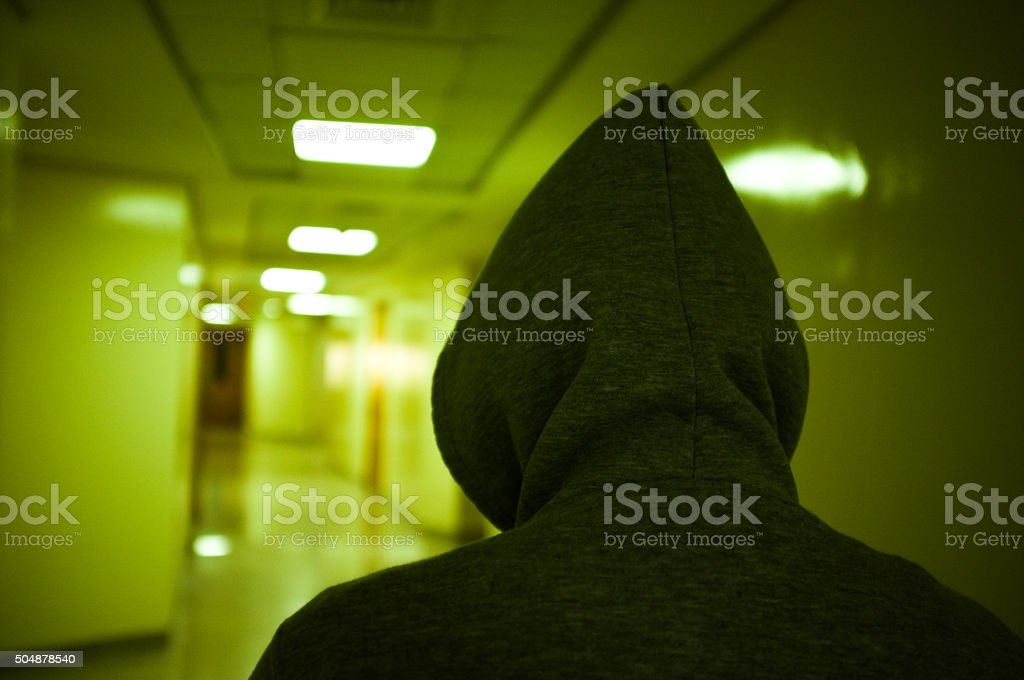 Suspicious man in a residential building stock photo