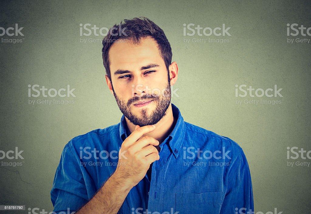 Suspicious skeptical man stock photo