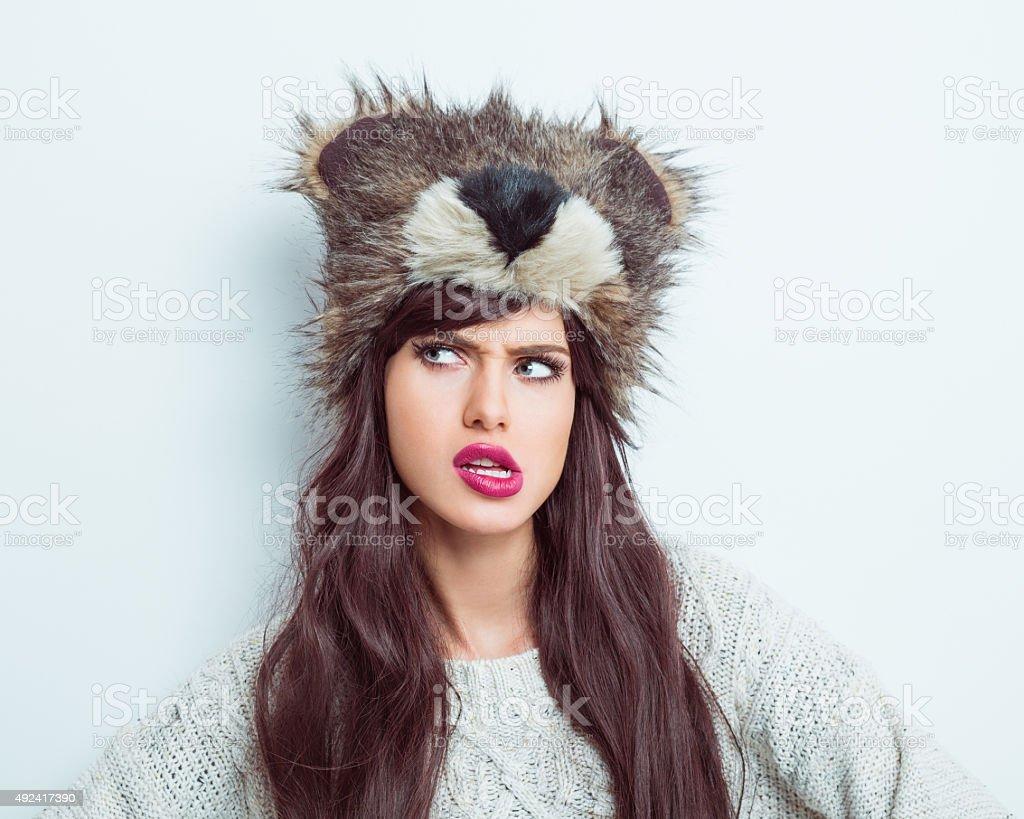 Suspicious woman wearing fur cap stock photo