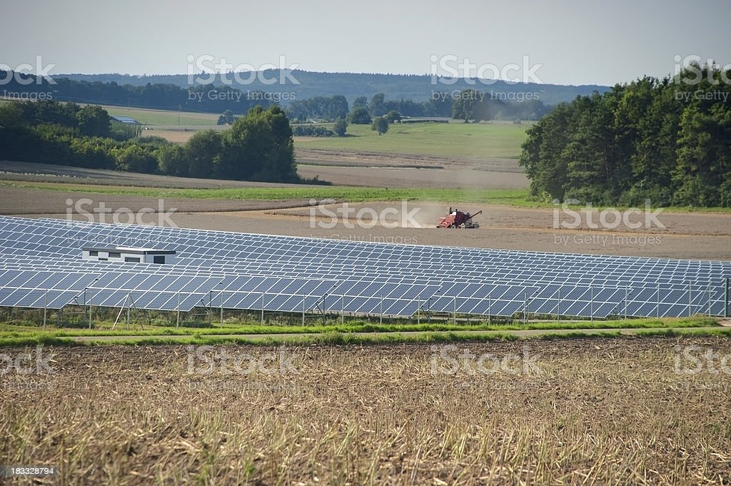 sustainability solar panels on rural agriculture farm stock photo