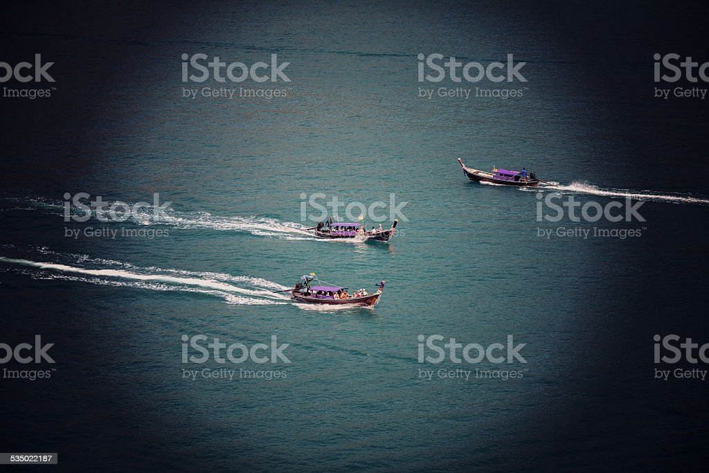 Sutro Filter Effect picture of three motorboats. stock photo