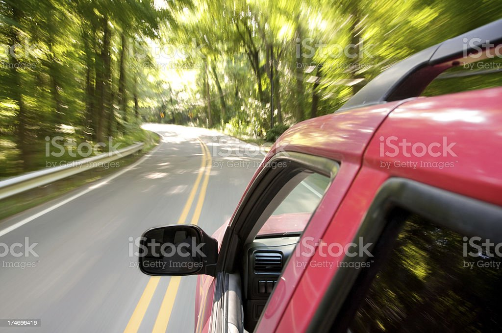suv driving through country roads royalty-free stock photo