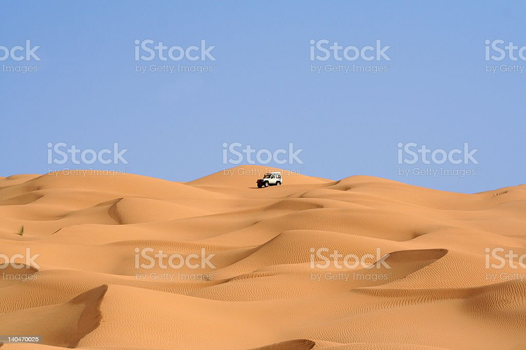 Suv in the desert dunes royalty-free stock photo