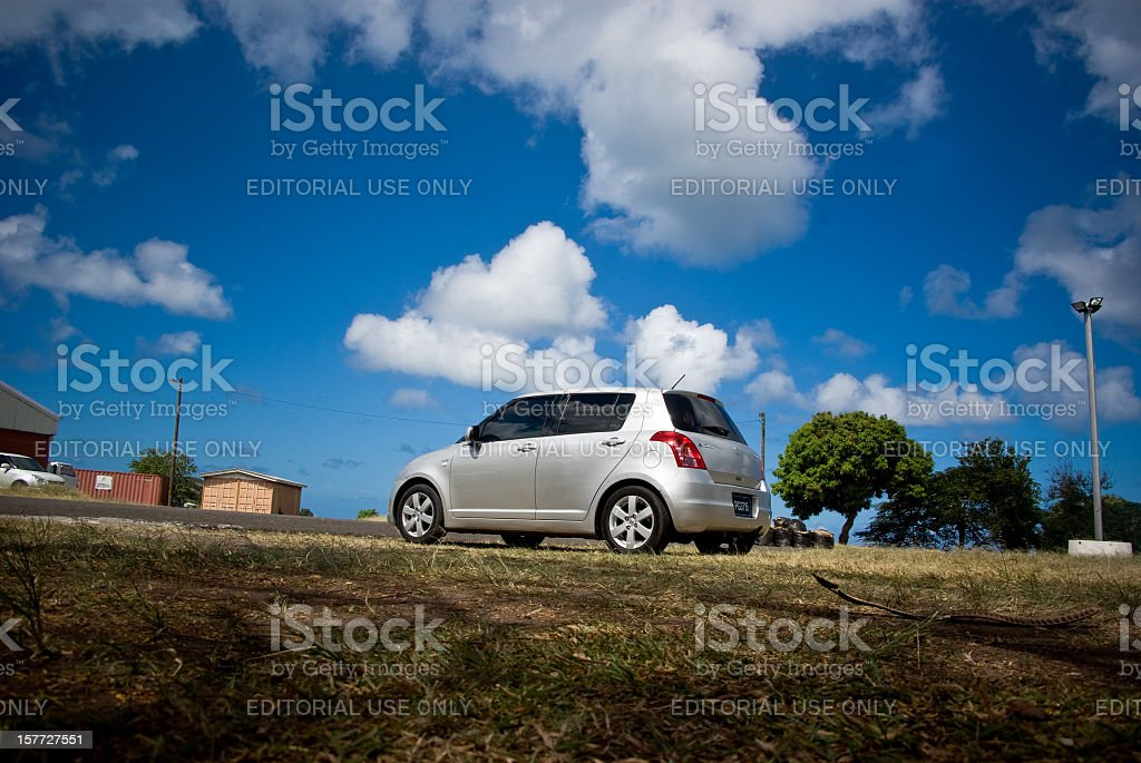 Suzuki Swift silver, parked in open field royalty-free stock photo