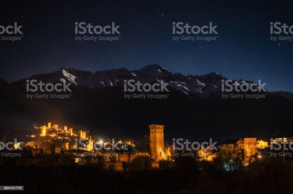 Svan towers with illumination in Mestia at night, Svaneti, Georgia. stock photo