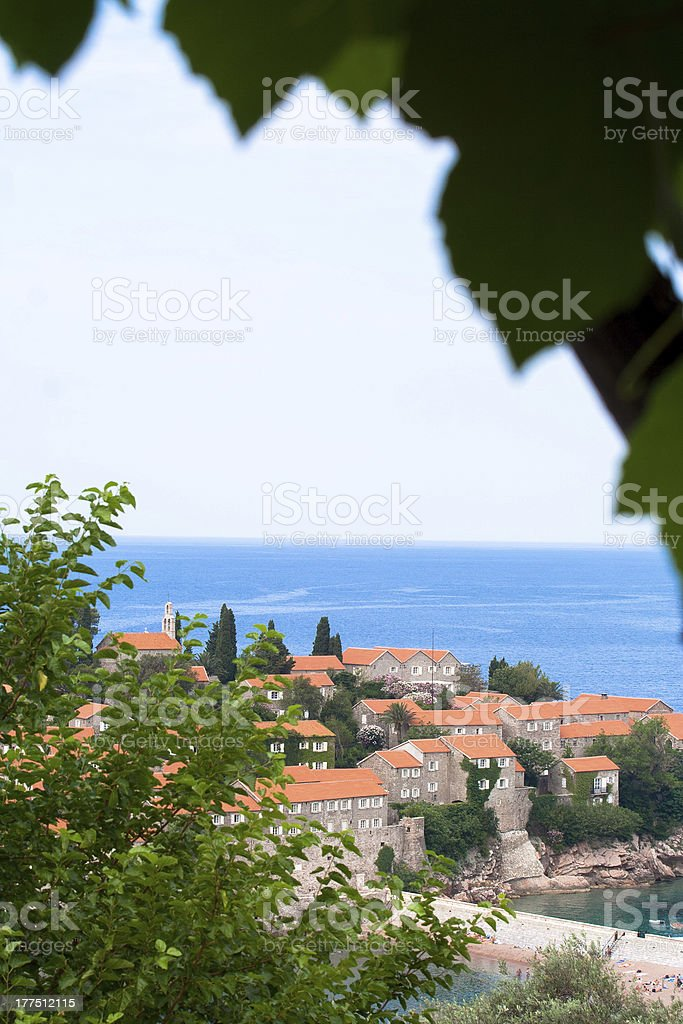 Sveti Stefan through leaves royalty-free stock photo