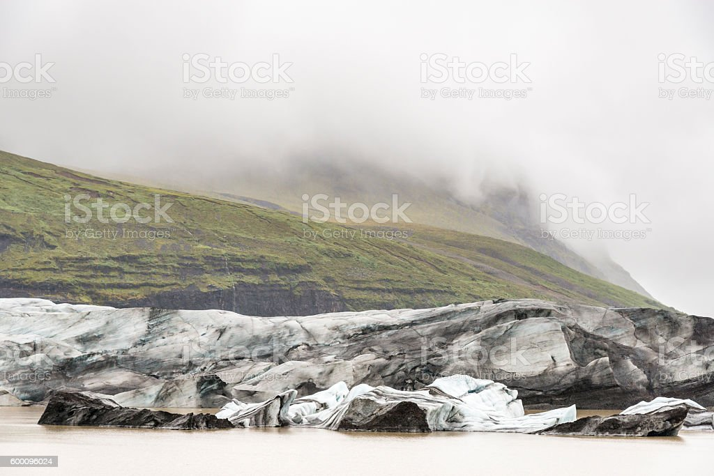 Svinafellsjokull glacier in the mist. Vatnajokull National Park. Iceland. stock photo