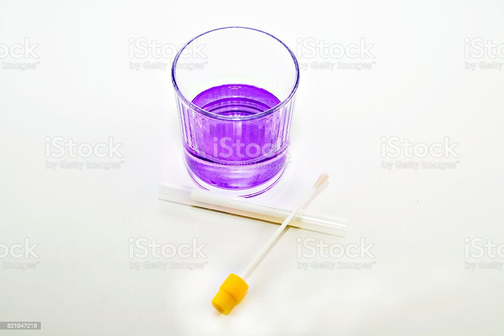 Swab and chemicals in glass stock photo