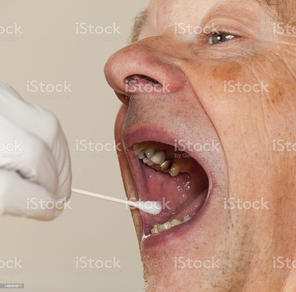 DNA swab of saliva taken from senior man stock photo