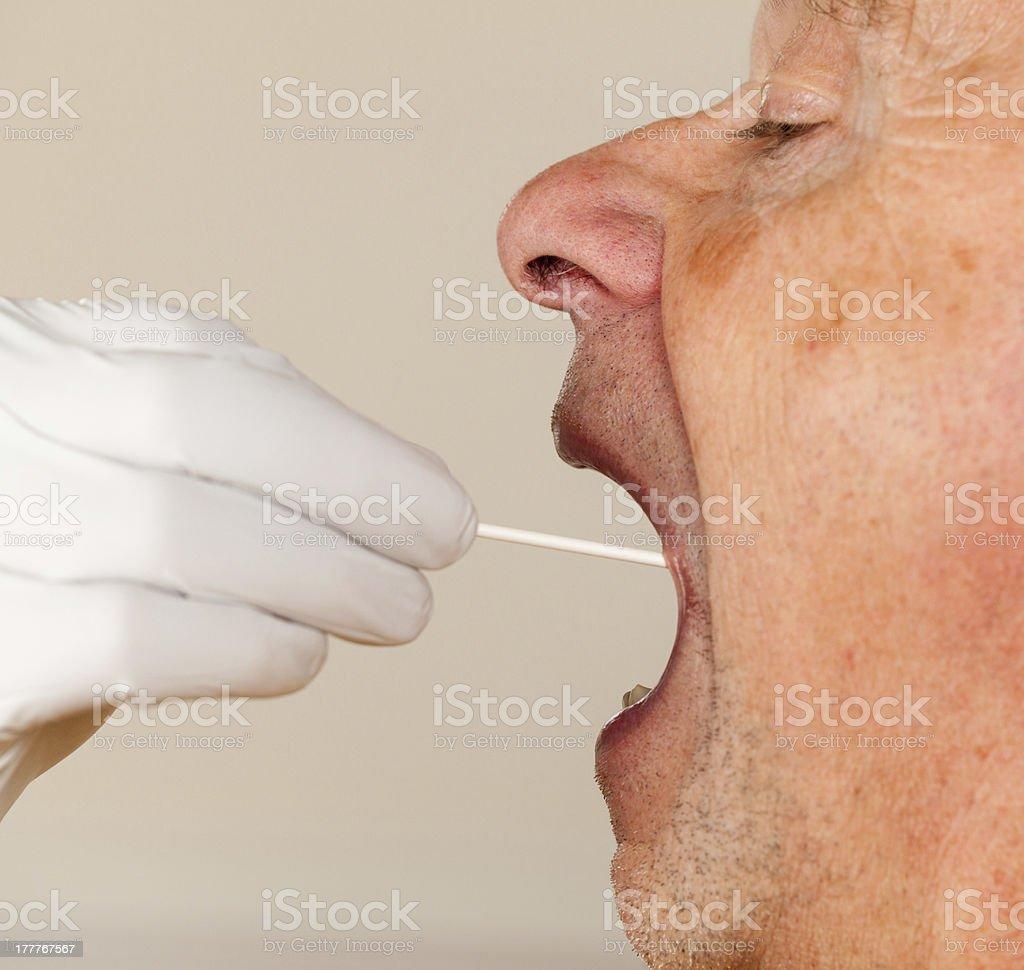 DNA swab of saliva taken from senior man stock photo