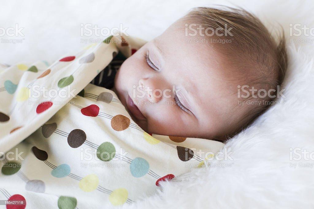 Swaddled sleeping Baby boy stock photo