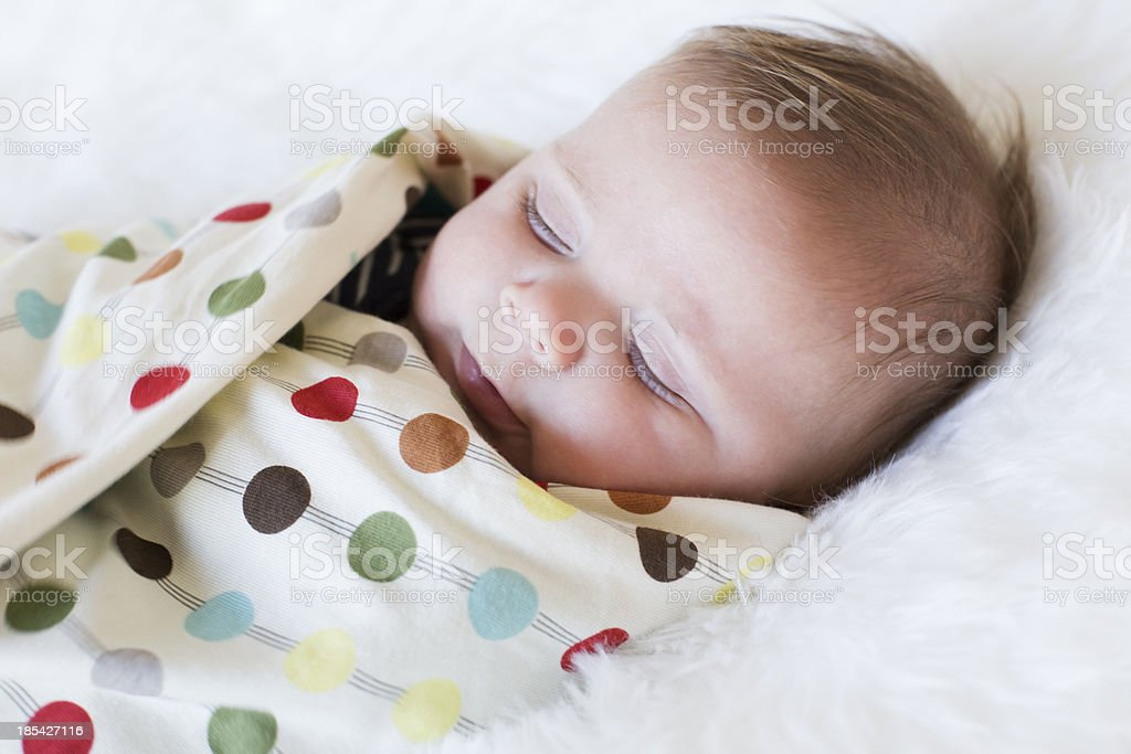 Swaddled sleeping Baby boy stock photo