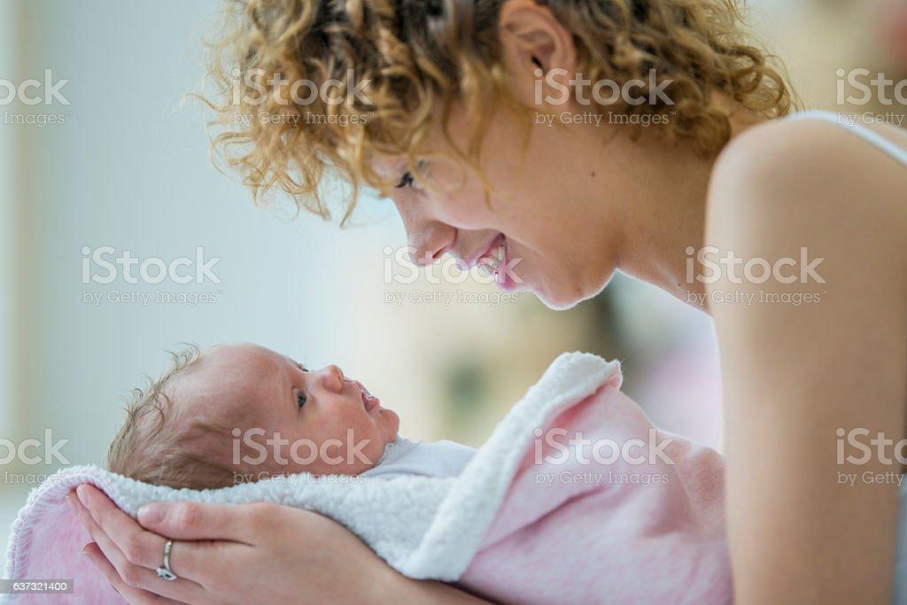 Swaddling a Baby Girl stock photo