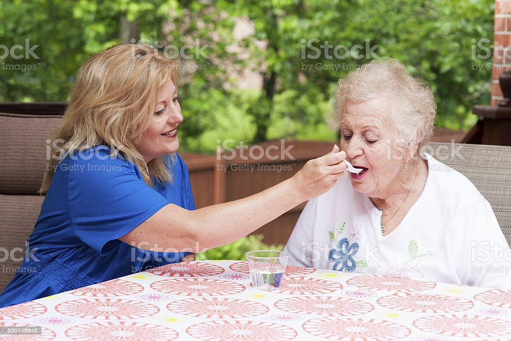 Swallowing therapy in stroke rehabilitation at home stock photo