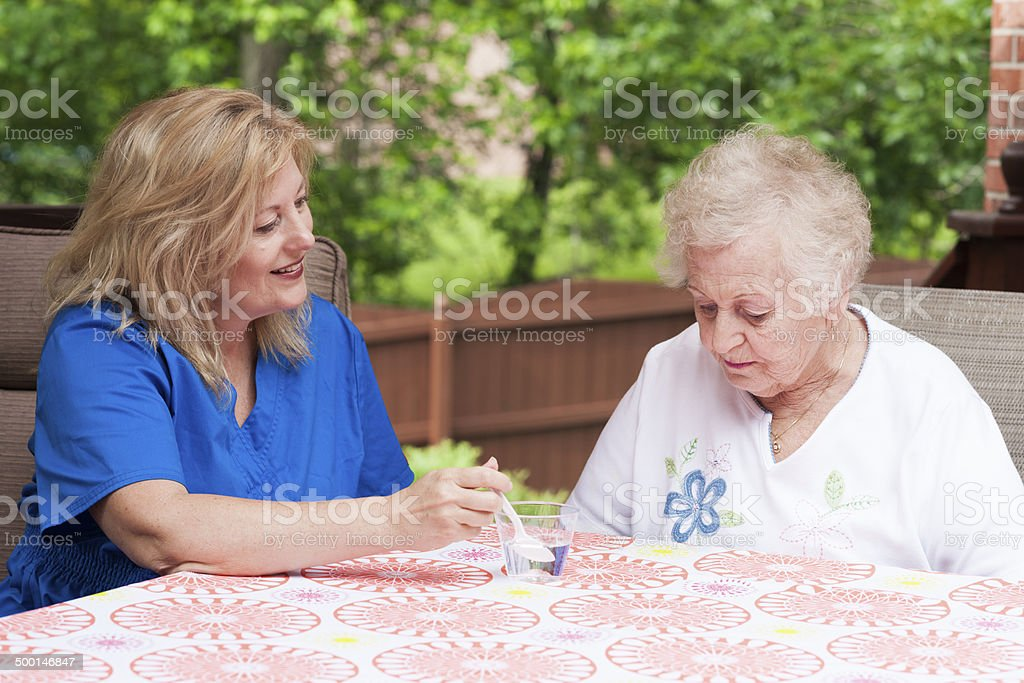 Swallowing treatment after a stroke stock photo
