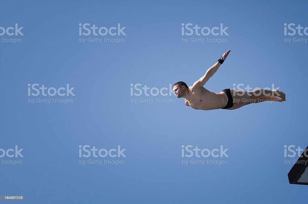 Swan dive from 10 meter high platform royalty-free stock photo