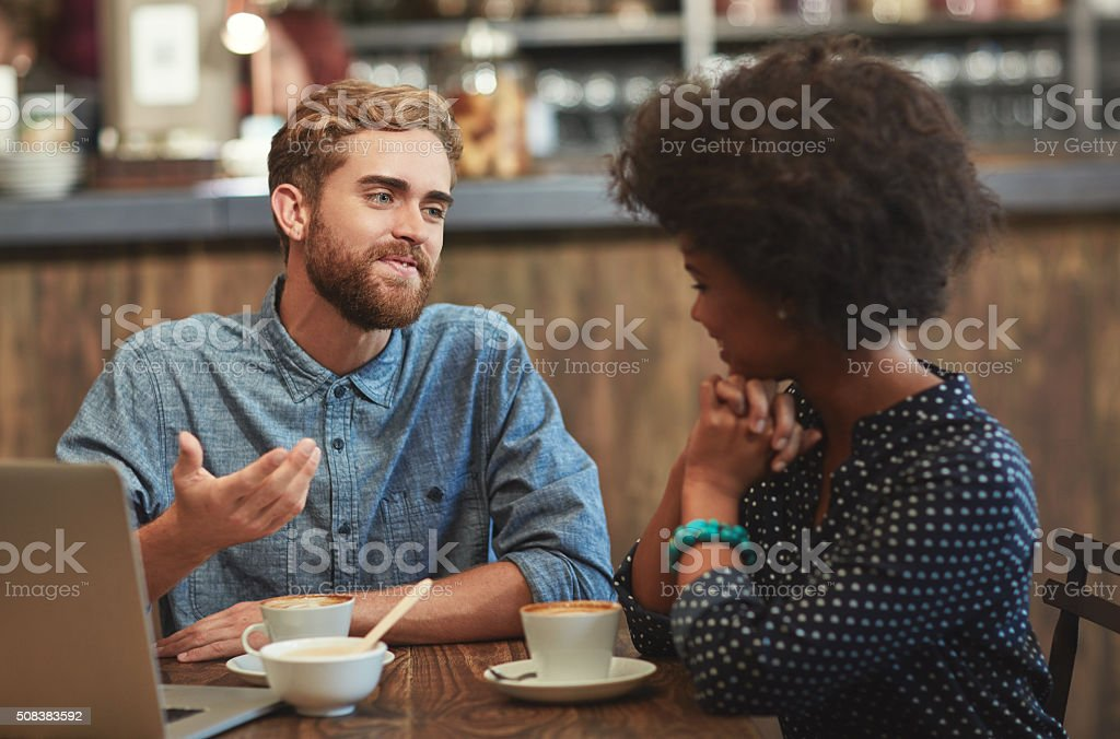 Swapping ideas over coffee stock photo