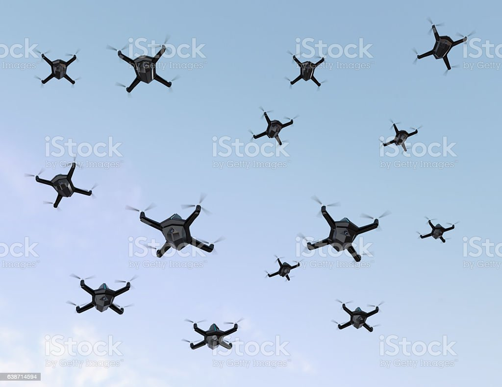 Swarm of drones flying in the sky stock photo