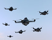 Swarm of drones flying in the sky