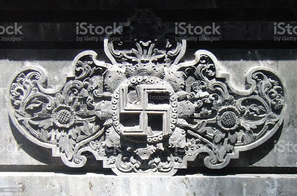 Swastika carving in Bali, Indonesia stock photo