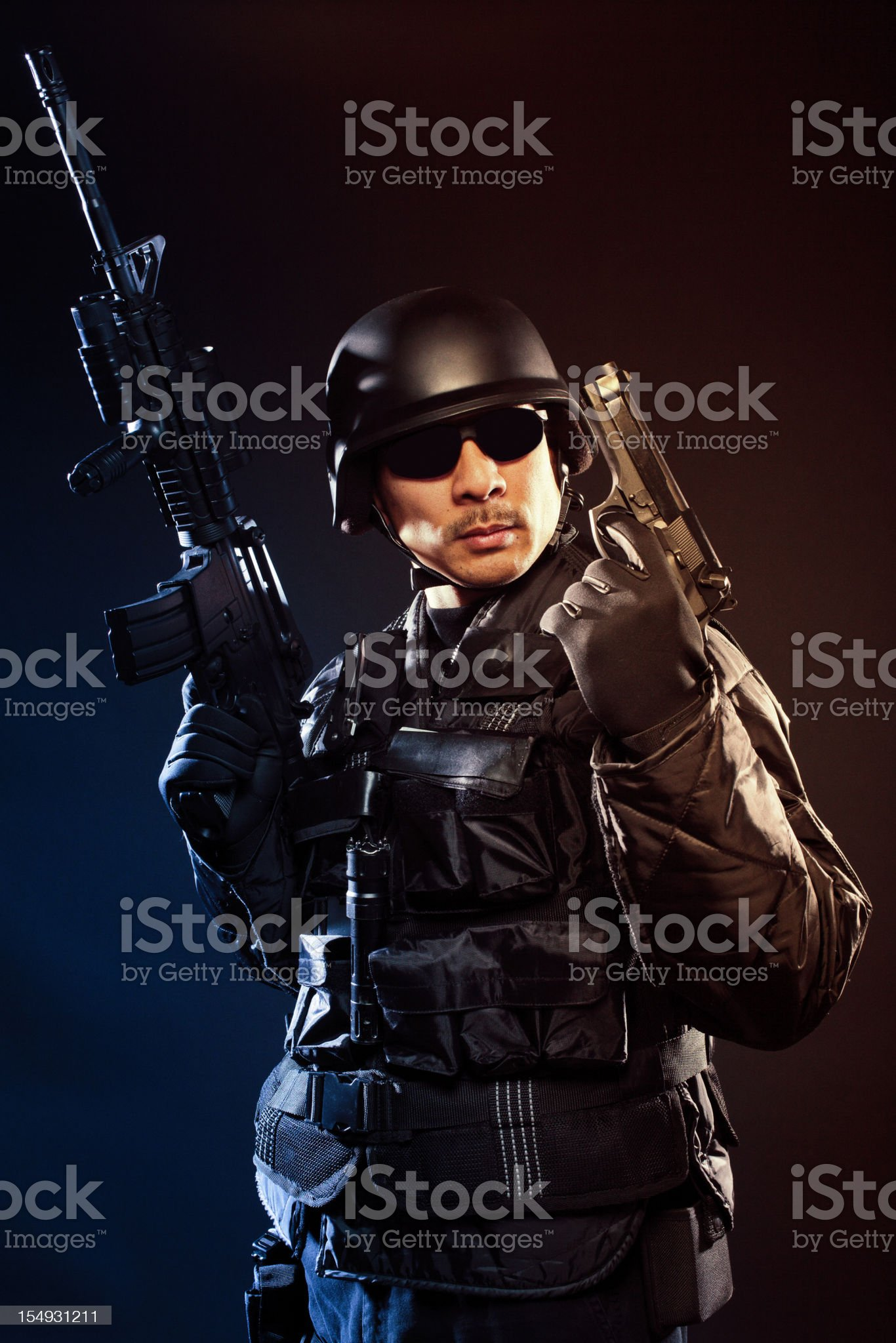 Swat team member holding a gun and colt royalty-free stock photo