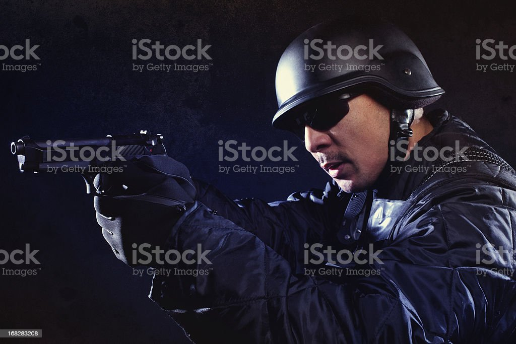 Swat team member holding a hand gun royalty-free stock photo