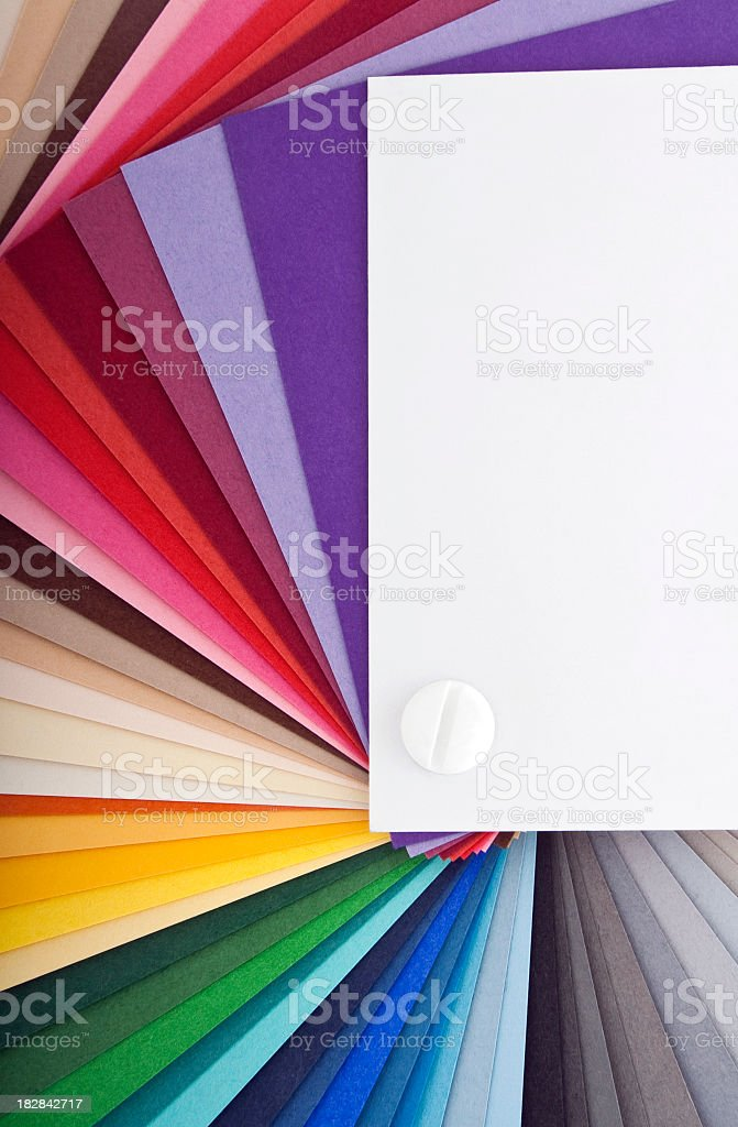 Swatch card fanned out to show spectrum of colors stock photo