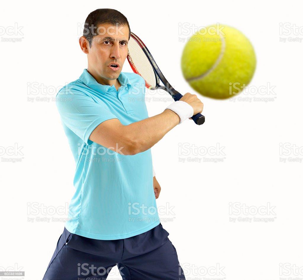 swatting this tennis ball stock photo