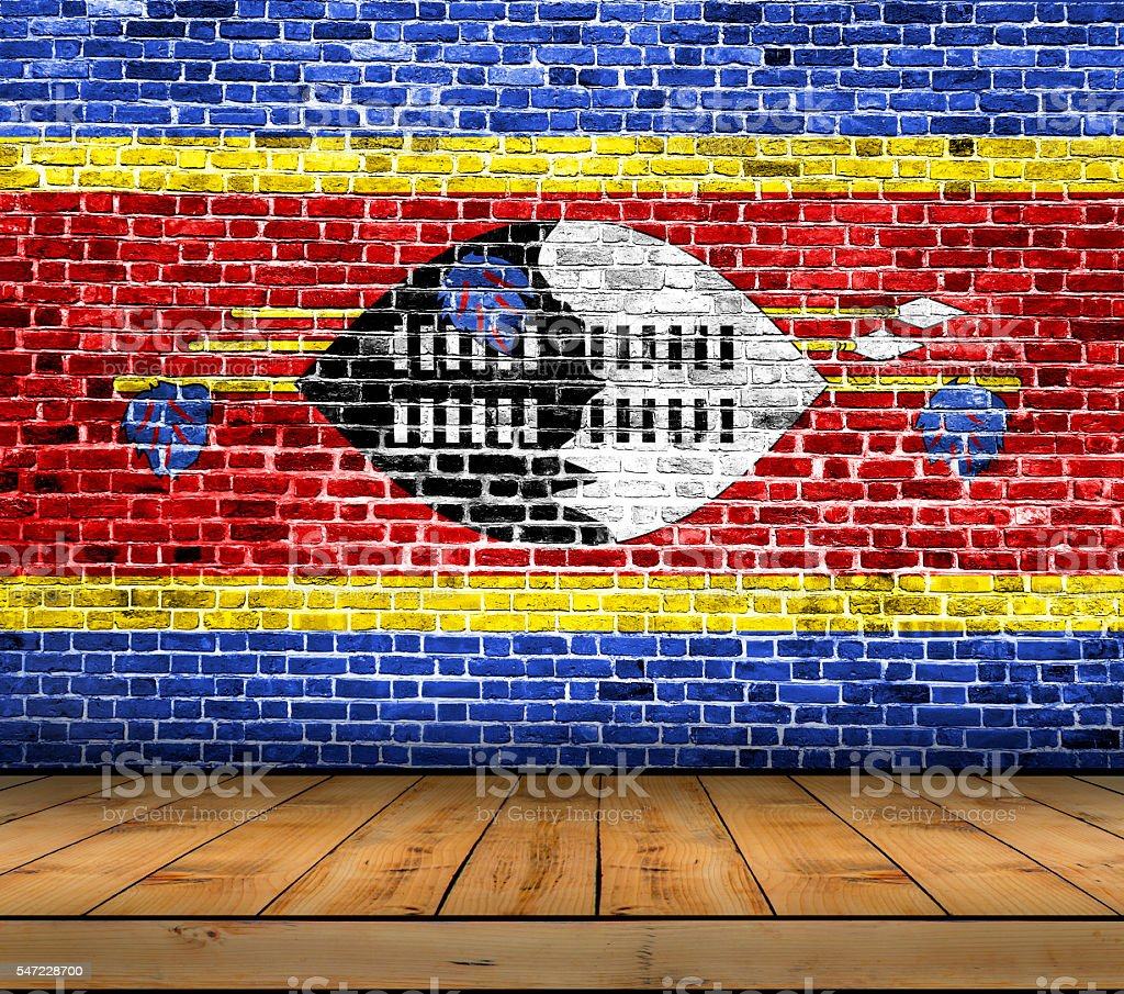 Swaziland flag painted on brick wall with wooden floor stock photo