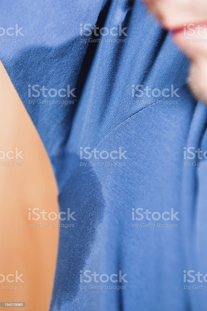 Sweat spot with part of anonymous face stock photo