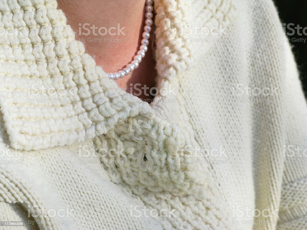 Sweater and pearls. royalty-free stock photo