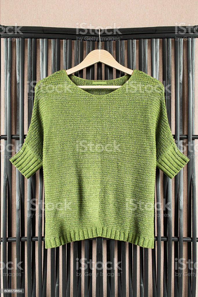 Sweater on clothes rack stock photo