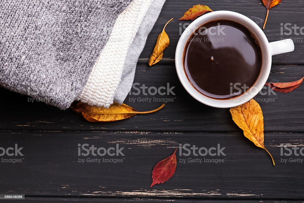 Sweaters, yellow leaves and hot coffe stock photo