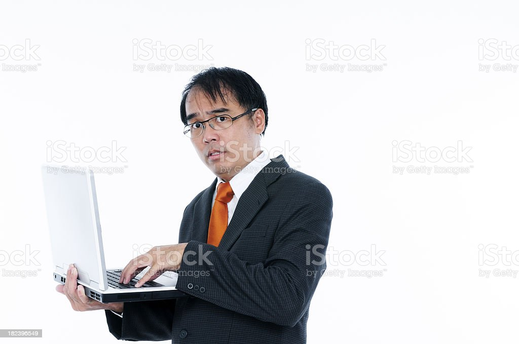 Sweating and nervous businessman using a laptop stock photo