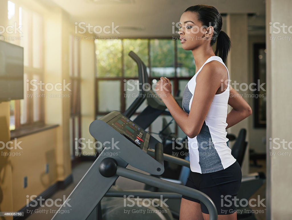 Sweating it out on the treadmill stock photo