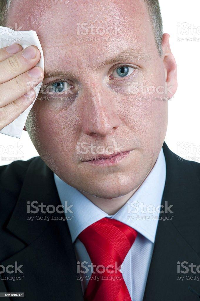 Sweaty Businessman Wiping Forehead royalty-free stock photo