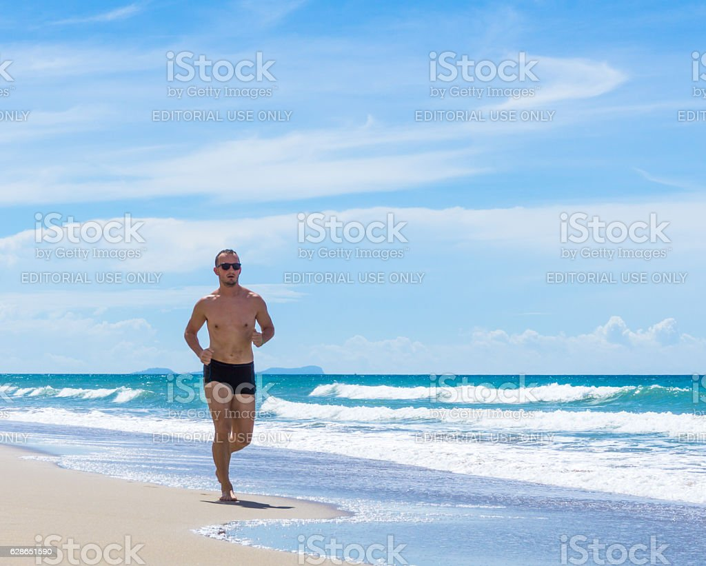 Sweaty Handsome Man Power Walking Fitness Exercise Beach Thailand stock photo