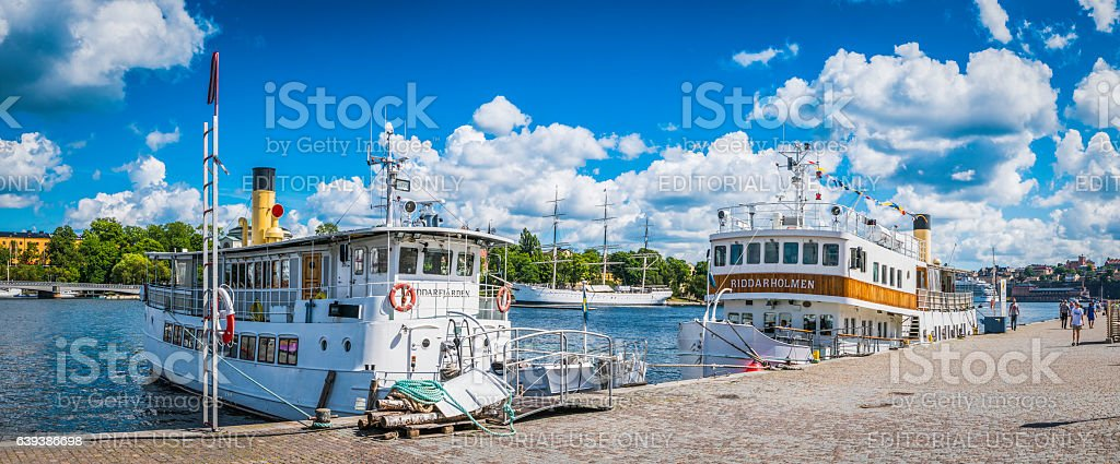 Sweden ferries moored in summer harbour panorama Gamla Stan Stockholm stock photo