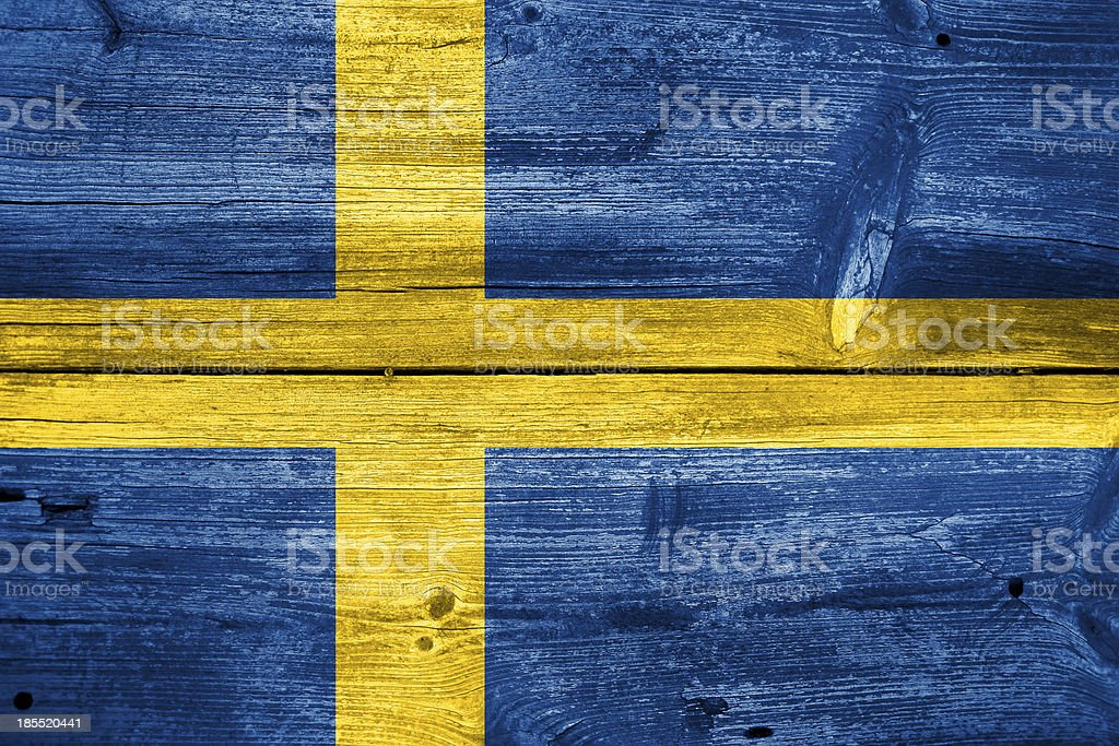 Sweden Flag painted on old wood plank background royalty-free stock photo