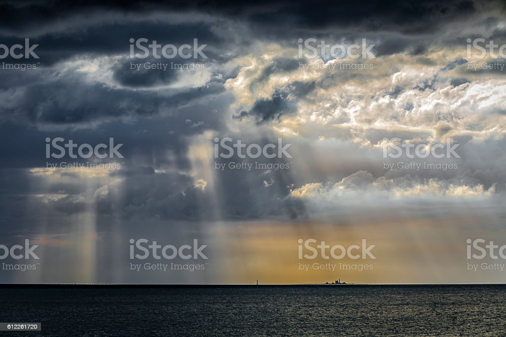 Sweden, lighthouse under dramatic sky stock photo