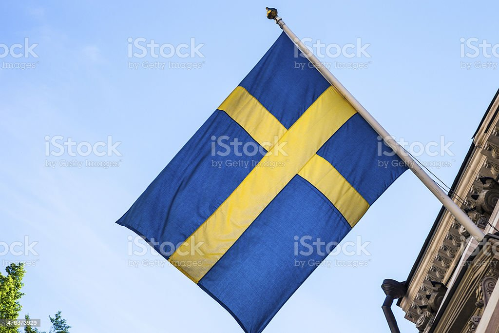 Sweden national flag on a Government building royalty-free stock photo