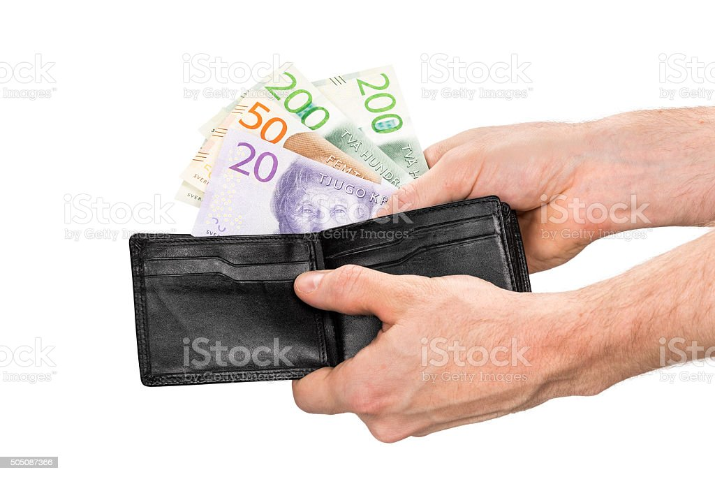 Swedish banknotes is taken out from a black leather wallet stock photo
